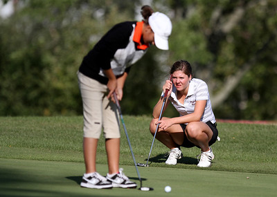 Mike Greene - mgreene@shawmedia.com Prairie Ridge's Delainey Peterson (right) watches Crystal Lake Central's Larisa Luloff putt on hole 3 during a dual meet Wednesday, September 19, 2012 at Turnberry Country Club in Lakewood. Crystal Lake Central won the meet.