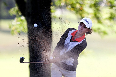Mike Greene - mgreene@shawmedia.com Crystal Lake Central's Larisa Luloff hits out of a bunker on hole 4 during a dual meet against Prairie Ridge Wednesday, September 19, 2012 at Turnberry Country Club in Lakewood. Crystal Lake Central won the meet.