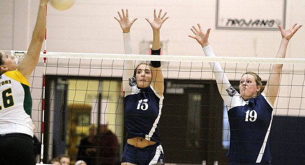 Mike Greene - mgreene@shawmedia.com Cary-Grove's Jess Bartczyszyn (center) and teammate Mallory Wilczynski jump to defend against a spike from Crystal Lake South's Carly Nolan during a match Thursday, September 27, 2012 at Cary-Grove High School in Cary. Crystal Lake South (19-6) defeated Cary-Grove (10-9) in straight sets.