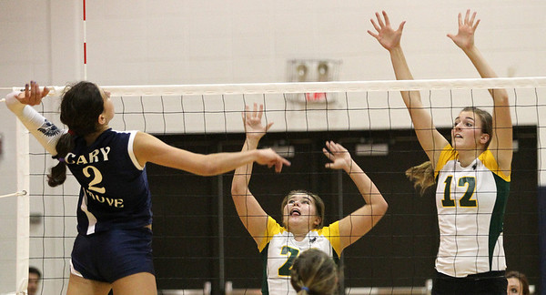 Mike Greene - mgreene@shawmedia.com Crystal Lake South's Lindsey Murphy (center) and Nicole Slimko prepare to defend a hit by Cary-Grove's Alex Larsen during a match Thursday, September 27, 2012 at Cary-Grove High School in Cary. Crystal Lake South (19-6) defeated Cary-Grove (10-9) in straight sets.