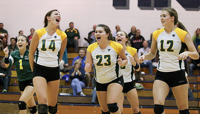 Mike Greene - mgreene@shawmedia.com Crystal Lake South's (from left) Avalon Nero, Lindsey Murphy, and Nicole Slimko and teammates celebrate after winning a point in the second set of a match against Cary-Grove Thursday, September 27, 2012 at Cary-Grove High School in Cary. Crystal Lake South (19-6) defeated Cary-Grove (10-9) in straight sets.