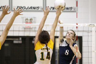 Mike Greene - mgreene@shawmedia.com Cary-Grove's Abby Schebel (right) follws through after hitting the ball as Crystal Lake South's Avalon Nero tips the ball during a match Thursday, September 27, 2012 at Cary-Grove High School in Cary. Crystal Lake South (19-6) defeated Cary-Grove (10-9) in straight sets.