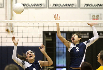 Mike Greene - mgreene@shawmedia.com Cary-Grove's Kayli Trausch (left) and Alex Larsen react as a ball passes by them during a match against Crystal Lake South Thursday, September 27, 2012 at Cary-Grove High School in Cary. Crystal Lake South (19-6) defeated Cary-Grove (10-9) in straight sets.