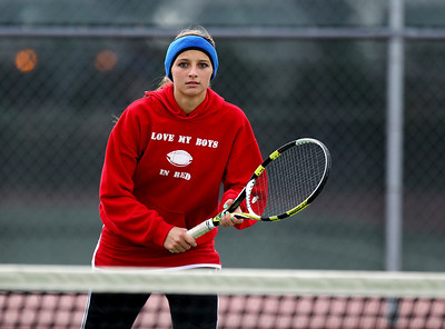 Mike Greene - mgreene@shawmedia.com Marian Central's Alissa Melchionna waits for a serve near the net during a first round doubles match against Hononegah in the Cary-Grove Invite Saturday, September 22, 2012 at Cary-Grove High School.