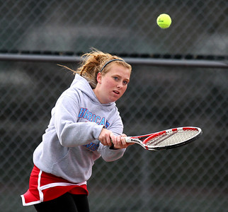 Mike Greene - mgreene@shawmedia.com Marian Central's Sarah Quinlan returns a volley during a first round doubles match against Hononegah in the Cary-Grove Invite Saturday, September 22, 2012 at Cary-Grove High School.