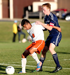 Josh Peckler - Jpeckler@shawmedia.com Cary-Grove's Brian O'Connor defends Mchenry's Tony Quintero during the second half at Mchenry High School Monday, September 24, 2012.