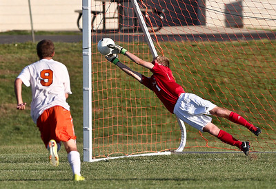 Josh Peckler - Jpeckler@shawmedia.com Cary-Grove goalie Kevin Schenk makes a diving save after a shot from Mchenry's Ryan Uhl during the second half at Mchenry High School Monday, September 24, 2012.
