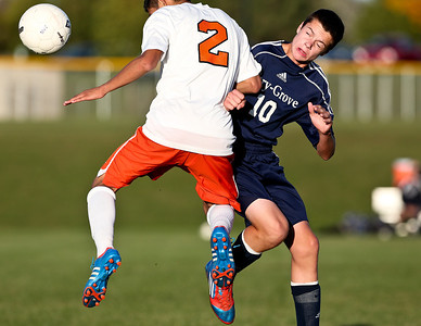 Josh Peckler - Jpeckler@shawmedia.com Cary-Grove's Dale Opasser (10) and Mchenry's Eric Darte fight for a header during the second the first half at Mchenry High School Monday, September 24, 2012.