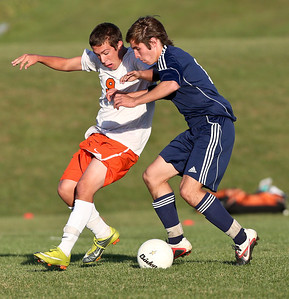 Josh Peckler - Jpeckler@shawmedia.com Mchenry's Ryan Uhl (9) and Cary-Grove's Mike McKune fight for possession of the ball during the first half at Mchenry High School Monday, September 24, 2012.