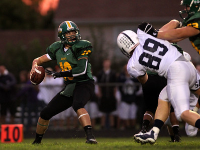 Mike Greene - mgreene@shawmedia.com Crystal Lake South quarterback Austin Rogers drops back to pass in the first quarter of a conference game against Cary-Grove Friday, September 7, 2012 at Crystal Lake South High School. Cary-Grove won the game 17-3.