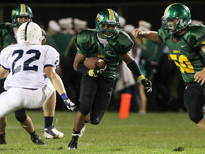 Mike Greene - mgreene@shawmedia.com Crystal Lake South running back Zevin Clark looks for space during a run in the second quarter of a conference game against Cary-Grove Friday, September 7, 2012 at Crystal Lake South High School. Cary-Grove won the game 17-3.