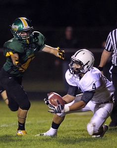 Mike Greene - mgreene@shawmedia.com Cary-Grove running back Ryan Mahoney hauls in a 30-yard pass as Crystal Lake South defensive back Casey Oliver defends in the second quarter of a conference game Friday, September 7, 2012 at Crystal Lake South High School. Mohoney's reception set up a Cary-Grove touchdown and the Trojans went on to win the game 17-3.