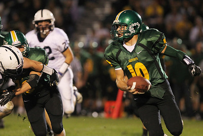 Mike Greene - mgreene@shawmedia.com Crystal Lake South quarterback Austin Rogers scrambles in the first quarter of a conference game against Cary-Grove Friday, September 7, 2012 at Crystal Lake South High School. Cary-Grove won the game 17-3.