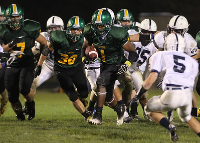 Mike Greene - mgreene@shawmedia.com Crystal Lake South running back Zevin Clark breaks by Cary-Grove defenders during a run in the third quarter of a conference game Friday, September 7, 2012 at Crystal Lake South High School. Cary-Grove won the game 17-3.