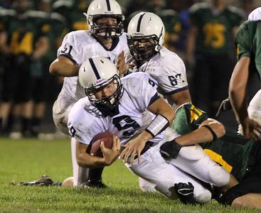 Mike Greene - mgreene@shawmedia.com Cary-Grove quarterback Quinn Baker is takled during a run by Crystal Lake South linebacker Josh Smith during the second quarter of a conference game Friday, September 7, 2012 at Crystal Lake South High School. Cary-Grove won the game 17-3.