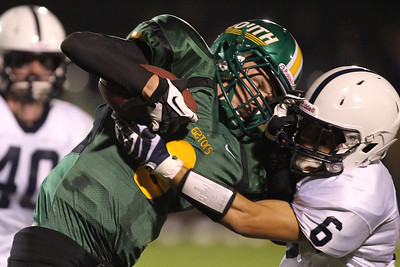 Mike Greene - mgreene@shawmedia.com Crystal Lake South wide receiver Eric Schiller comes up against Cary-Grove defensive back Marcus Thimios after a reception in the second quarter of a conference game Friday, September 7, 2012 at Crystal Lake South High School. Thimios stripped the ball from Schiller on the play, helping Cary-Grove win the game 17-3.