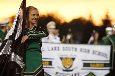 Mike Greene - mgreene@shawmedia.com Members of the Crystal Lake South color guard and band perform before the start of a conference game against Cary-Grove Friday, September 7, 2012 at Crystal Lake South High School. Cary-Grove won the game 17-3.