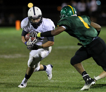 Mike Greene - mgreene@shawmedia.com Cary-Grove running back Ryan Mahoney comes up against Crystal Lake South defensive back Zevin Clark during a run in the third quarter of a conference game Friday, September 7, 2012 at Crystal Lake South High School. Cary-Grove won the game 17-3.