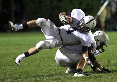 Mike Greene - mgreene@shawmedia.com Cary-Grove running back Ryan Mahoney flips over a teammate during a run in the third quarter of a conference game against Crystal Lake South Friday, September 7, 2012 at Crystal Lake South High School. Cary-Grove won the game 17-3.