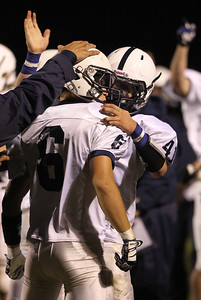 Mike Greene - mgreene@shawmedia.com Cary-Grove's Zach Marszal (right) congratulates teammate Marcus Thimios after stripping the ball from a Crystal Lake South player during a run in the second quarter of a conference game Friday, September 7, 2012 at Crystal Lake South High School. Cary-Grove won the game 17-3.