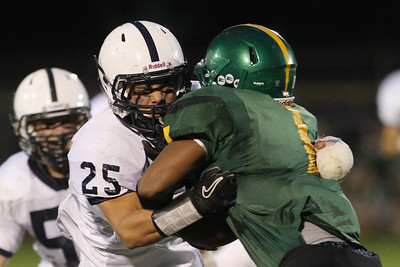 Mike Greene - mgreene@shawmedia.com Cary-Grove defensive back Jakub Ksiazek wraps up Crystal Lake South running back Zevin Clark in the first quarter of a conference game Friday, September 7, 2012 at Crystal Lake South High School. Cary-Grove won the game 17-3.