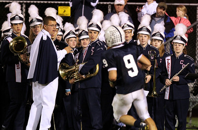 Mike Greene - mgreene@shawmedia.com Members of the Cary-Grove marching band watch as Cary-Grove quarterback Quinn Baker scores a touchdown during the second quarter of a game against Jacobs Friday, September 21, 2012 at Cary-Grove High School. Cary-Grove (5-0) defeated Jacobs (3-2) 45-14 to remain undefeated.
