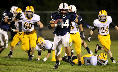 Mike Greene - mgreene@shawmedia.com Cary-Grove running back Kyle Norberg runs past Jacobs defenders en route to a touchdown during the first quarter of a game Friday, September 21, 2012 at Cary-Grove High School. Norberg tallied 273 yards and 3 touchdowns, helping Cary-Grove (5-0) defeat Jacobs (3-2) 45-14 to remain undefeated.