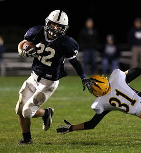 Mike Greene - mgreene@shawmedia.com Cary-Grove running back Kasey Fields runs past Jacobs defensive back Sean McAvoy during the second quarter of a game Friday, September 21, 2012 at Cary-Grove High School. Cary-Grove (5-0) defeated Jacobs (3-2) 45-14 to remain undefeated.