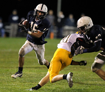 Mike Greene - mgreene@shawmedia.com Cary-Grove running back Kaene Connington runs behind a block by teammate Kasey Fields on Jacobs defensive back Sean McAvoy during the second quarter of a game Friday, September 21, 2012 at Cary-Grove High School. Cary-Grove (5-0) defeated Jacobs (3-2) 45-14 to remain undefeated.