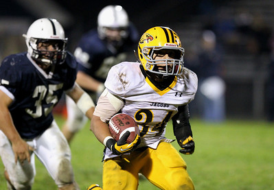 Mike Greene - mgreene@shawmedia.com Jacobs running back Steven Varela looks for running room while being chased by Cary-Grove linebacker Patrick O'Malley during the third quarter of a game Friday, September 21, 2012 at Cary-Grove High School. Cary-Grove (5-0) defeated Jacobs (3-2) 45-14 to remain undefeated.