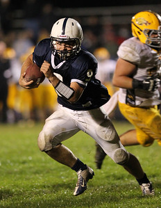 Mike Greene - mgreene@shawmedia.com Cary-Grove quarterback Quinn Baker runs during the third quarter of a game against Jacobs Friday, September 21, 2012 at Cary-Grove High School. Cary-Grove (5-0) defeated Jacobs (3-2) 45-14 to remain undefeated.