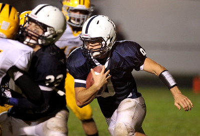 Mike Greene - mgreene@shawmedia.com Cary-Grove quarterback Quinn Baker rushes during the third quarter of a game against Jacobs Friday, September 21, 2012 at Cary-Grove High School. Cary-Grove (5-0) defeated Jacobs (3-2) 45-14 to remain undefeated.