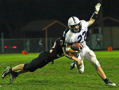Brett Moist/ For the Northwest Herald  Cary Grove's Kasey Fields runs past Mchenry's  Jake Huffman during the 3rd Quarter of Gameplay at Mchenry High School on Friday. Cary Grove defeated Mchenry 42-3.