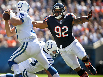Josh Peckler - Jpeckler@shawmedia.com The Chicago Bears' Matt Spaeth (92) chases down Indianapolis quarterback Andrew Luck during the third quarter at Soldier Field Sunday, September 9, 2012. The Bears defeated the Colts 41- 21 in the season opener in Chicago.