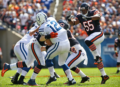 Josh Peckler - Jpeckler@shawmedia.com The Chicago Bears' Lance Briggs (55) jumps up as he prepares to help sack Indianapolis quarterback Andrew Luck during third quarter at Soldier Field Sunday, September 9, 2012. The Bears defeated the Colts 41- 21 in the season opener in Chicago.