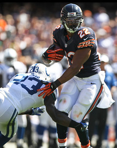 Josh Peckler - Jpeckler@shawmedia.com The Chicago Bears' Matt Forte shrugs off Indianapolis' Vontae Davis during the first quarter at Soldier Field Sunday, September 9, 2012. The Bears defeated the Colt 41- 21 in the season opener in Chicago.