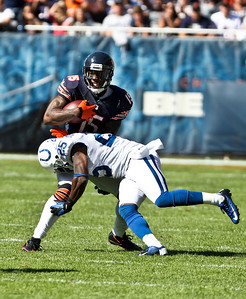 Josh Peckler - Jpeckler@shawmedia.com The Chicago Bears' Brandon Marshall (15) gets hit by the Indianapolis Colt's Jerraud Powers after receiving a pass in the forth quarter at Soldier Field Sunday, September 9, 2012. The Bears defeated the Colts 41- 21 in the season opener in Chicago.