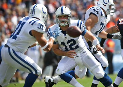 Josh Peckler - Jpeckler@shawmedia.com Indianapolis Colts quarterback Andrew Luck pitches the ball back to Donald Brown during the second quarter at Soldier Field Sunday, September 9, 2012. The Bears defeated the Colts 41- 21 in the season opener in Chicago.