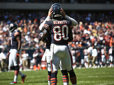 Josh Peckler - Jpeckler@shawmedia.com The Chicago Bears Earl Bennett (80) gets a congratulation from quarterback Jay Cutler after almost scoring a touchdown during the third quarter at Soldier Field Sunday, September 9, 2012. The Bears defeated the Colts 41- 21 in the season opener in Chicago.