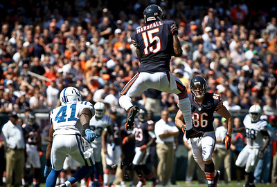 Josh Peckler - Jpeckler@shawmedia.com The Chicago Bears' Brandon Marshall goes airborne to catch a pass in next to Indianapolis's Antoine Bethea (41) after receiving a pass in the second quarter at Soldier Field Sunday, September 9, 2012. The Bears defeated the Colts 41- 21 in the season opener in Chicago.