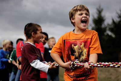 Sarah Nader - snader@shawmedia.com Landon Lamarca, 7, of Pingree Grove plays a game of tug-of-war against the girls while attending a rally for childhood cancer awareness month at Cambridge Lakes Charter School in Pingree Grove on Thursday, September 27, 2012.
