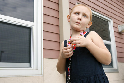 Sarah Nader - snader@shawmedia.com Ella Van Gheem, 6, of Gilberts attends a rally for childhood cancer awareness month at Cambridge Lakes Charter School in Pingree Grove on Thursday, September 27, 2012. Ella was diagnoses with Leukemia two years ago and is still receiving treatment.