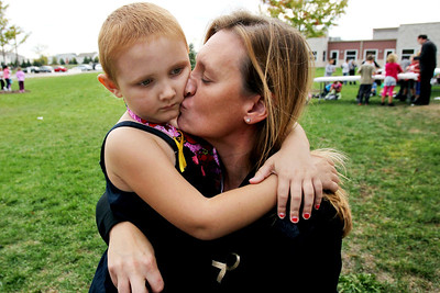 Sarah Nader - snader@shawmedia.com Ella Van Gheem, 6, of Gilberts hugs her mom, Katie, while attending a rally for childhood cancer awareness month at Cambridge Lakes Charter School in Pingree Grove on Thursday, September 27, 2012. Ella was diagnoses with Leukemia two years ago and is still receiving treatment.
