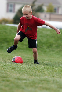 Sarah Nader - snader@shawmedia.com Nolan Henry, 7, of Algonquin runs a relay race while attending a rally for childhood cancer awareness month at Cambridge Lakes Charter School in Pingree Grove on Thursday, September 27, 2012.