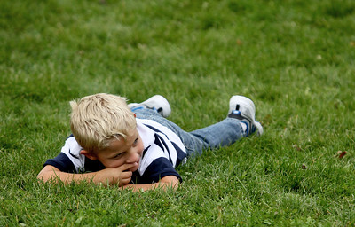 Sarah Nader - snader@shawmedia.com Blake Green, 6, of Carpentersville lays down after making a tie dye bandana during a rally for childhood cancer awareness month at Cambridge Lakes Charter School in Pingree Grove on Thursday, September 27, 2012.