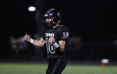 Sarah Nader - snader@shawmedia.com Woodstock North's quarterback Brian Loftin celebrates a touchdown during the first quarter of Friday's game against Crystal Lake Central  in Woodstock on Sepetmber 14, 2012. Crystal Lake Central won, 21-14.
