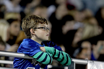 Sarah Nader - snader@shawmedia.com A boy watches Friday's Woodstock North game against Crystal Lake Central in Woodstock on Friday, September 14, 2012