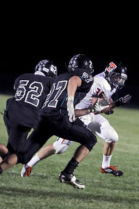 Sarah Nader - snader@shawmedia.com Woodstock North's Dylan Kline (left) and Adam Haimbaugh try to tacked Crystal Lake Central's Tyler Jenkins while he makes a touchdown during fourth quarter during Friday's game in Woodstock on September 14, 2012. Crystal Lake Central won, 21-14.