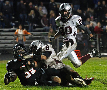 Brett Moist / For the Northwest Herald Crystal Lake Central's Tyler Jenkins is tackled at the 1 yard line by Nathan Kirchberg (left) after a huge gain in the 4th quarter of gameplay at Crystal Lake Central High School on Friday, Spetember 21, 2012 Austin Nirva (right)  was in pursuit. Crystal Lake Central defeated Prairie Ridge 7-3.