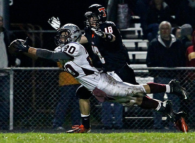 Brett Moist / For the Northwest Herald Prairie Ridge's Robin Barcroft catches the ball for the interception 4th quarter of gameplay against Prairie Ridge at Crystal Lake Central High School on Friday, September 21, 2012.  Crystal Lake Central's Luke Novy defends. Crystal Lake Central defeated Prairie Ridge 7-3.
